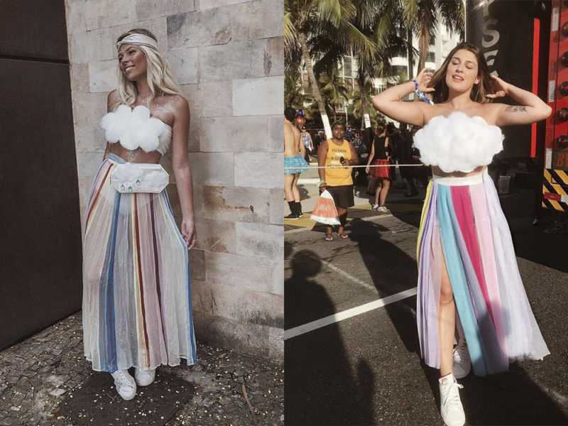 modelos vestindo fantasias de carnaval de arco-íris